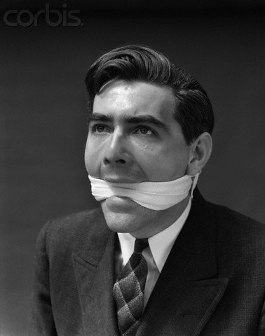 1930s Portrait Of Man With Gag In Mouth
