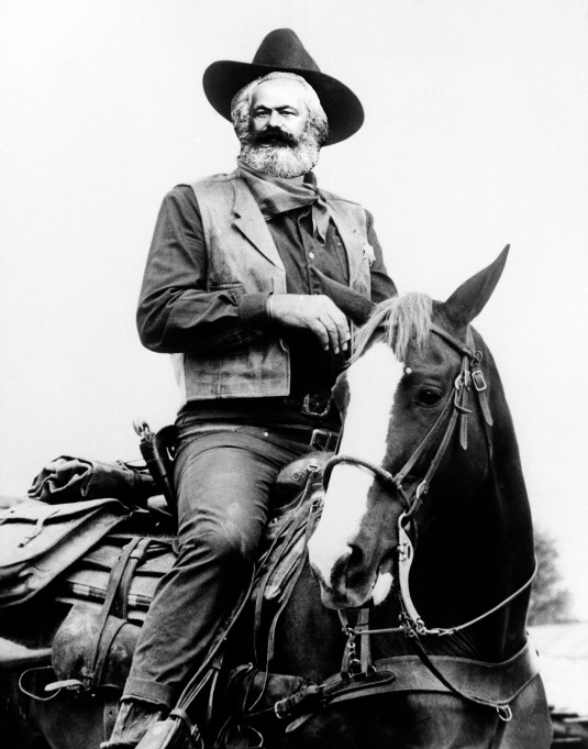 """**FILE**John Wayne appears in a scene from """"True Grit,"""" a Hal Wallis production, directed by Henry Hathaway. Wayne won his best-actor Oscar for his role in the 1969 movie. Wayne, born Marion Robert Morrison, would have turned 100 on Saturday, May 26, 2007. He died at the age of 72 of stomach cancer in June of 1979 after a career that spanned more than 170 films. (AP Photo)"""